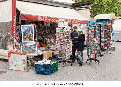 Barcelona, Spain-May 27, 2013: View of newsagent stall selling newspapers, magazines and tourist souvenirs on the famous Las Ramblas, Barcelona