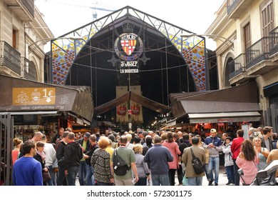 BARCELONA, SPAIN-MAY 6, 2016: Many people visit the market of La Boqueria in Barcelona