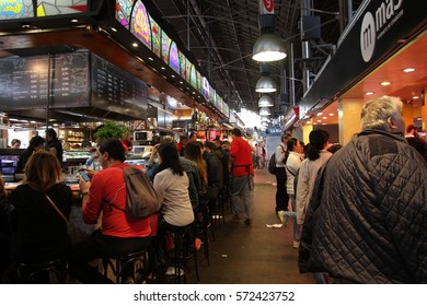 BARCELONA, SPAIN-MAY 6, 2016: People eating tapas in a tapas bar, La Boqueria in Barcelona