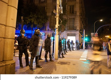 BARCELONA, SPAIN-NOVEMBER 14: Unidentified policemen stand by during European General Strike on November 14, 2012 in Barcelona Spain.