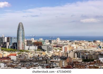 Barcelona urban skyline with sea construction cranes modern buildings