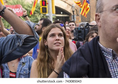 Barcelona,Catalonia,Spain-October,27,2017.Pujades Street. An expectant woman waiting the moment of the proclamation of the Catalonia Republic Watching the proclamation through a screen in the street.