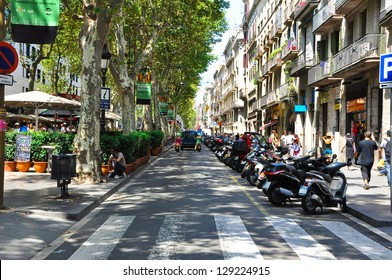 BARCELONA-JULY 25:La Rambla on July 25, 2012 in Barcelona. La Rambla is a street in Barcelona. It stretches for 1.2 kilometers between Barri Gotic and El Raval, leading to the Columbus Monument.