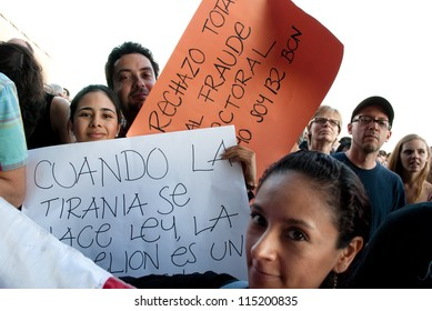 BARCELONA-JULY 6: Unidentified mexicans protest against the electoral fraud in Mexico during Julieta Venegas concert at the Cruilla Music Festival in Barcelona, on July 6, 2012.