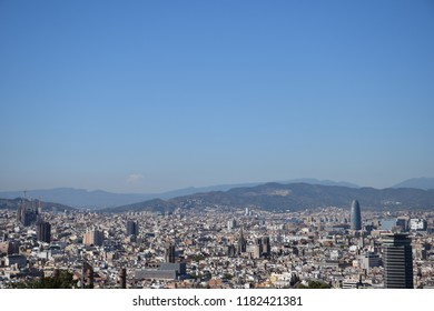 Barcelona's cityscape under clear blue sky