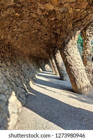 Barcelona/Spain - 08 03 2018: the stone  corridor (dragon bone) in Park Güell.