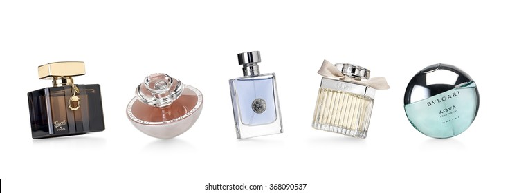 Barcelona-Spain- 12th December 2015- Studio shot of distinguished perfume brands for women and men photographed in a dynamic and funny positions.Gucci- Guerlain- Verssace-Chloe