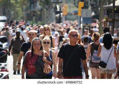 BARCELONA/SPAIN - 18 AUGUST 2017: Crowd on the Rambla the day after the terrorist attack in Barcelona. Credit:Dino Geromella
