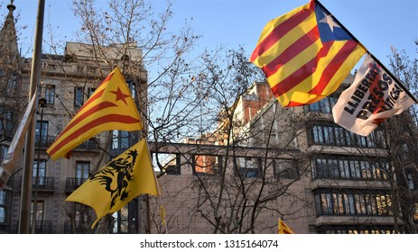 Barcelona/Spain 2019-02-16 Protest. Catalan secessionist flags, secessionist flag of Flanders and poster calling for the freedom of imprisoned politicians for violating the Spanish Constitution
