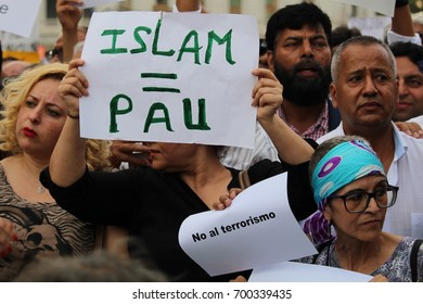 BARCELONA/SPAIN - 21 AUGUST 2017: Members of the muslim community protesting against terrorism in Plaza Catalunya after the attack on Ramblas a few days before. Credit: Dino Geromella/Shutterstock