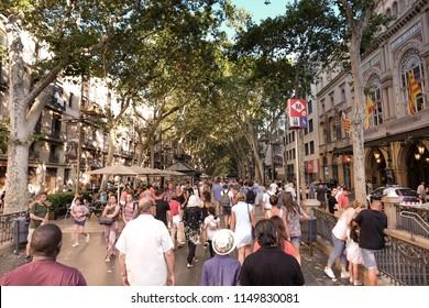 BARCELONA,SPAIN - JUL 19, 2018: La Rambla street. La Rambla is a street in central Barcelona, popular with tourists and locals alike.