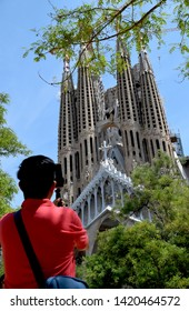 Barcelona/Spain - June 03 2019: Adult man taking photo of the famous cathedral La Sagrada Familia in Barcelona, Spain