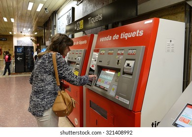 BARCELONA,SPAIN -  MAY 30, 2013: Buying a ticket on the Barcelona metro. Barcelona is the second largest city in Spain, the capital of the Autonomous region of Catalonia and of the province.