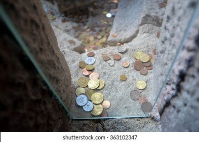 BARCELONA/SPAIN - OCTOBER 15 2012: Coins left by tourists in some of stairways of Sacred Family Church, Barcelona/Spain.