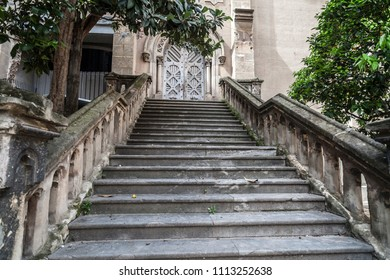 BARCELONA,SPAIN-APRIL 22,2018: Street view, stone stairs to ancient church in El Raval quarter in historic center of Barcelona.