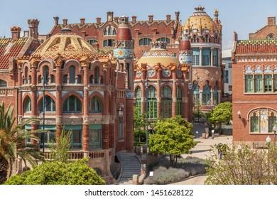 BARCELONA,SPAIN-APRIL 25,2019: Modernist style complex, Hospital de Sant Pau i de la Santa Creu, designed by Lluis Domenech i Montaner. UNESCO world heritage site.