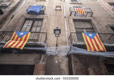 BARCELONA,SPAIN-APRIL 30, 2012: Old facade building, historic center, balconies with flags, estelada,independentist catalan flag, Barcelona.