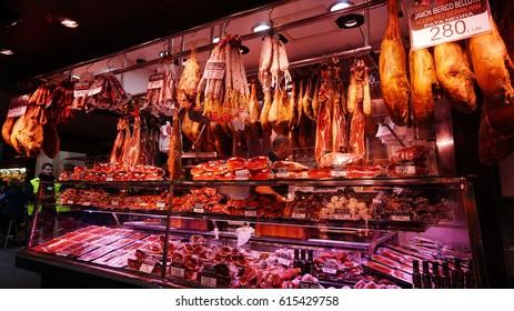 BARCELONA,SPAIN-FEB 18,2017: Meat store at La Boqueria market, next to Les Rambles in Barcelona, Catalonia, Spain