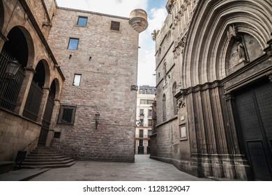 BARCELONA,SPAIN-JULY 5,2018: Old street in medieval gothic quarter, door entrance cathedral of Barcelona.