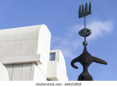 BARCELONA,SPAIN-MARCH 8,2016: Exterior foundation,Fundacio Miro,sculpture Moon,sun and one star by Joan Miro next to the building designed by Josep Lluis Sert,parc montjuic,Barcelona.