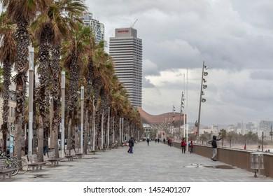 BARCELONA,SPAIN-OCTOBER 31,2019:  Maritime promenade and beach of La Barceloneta.