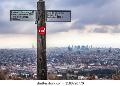 BARCELONA,SPAIN-SEPTEMBER 3,2018:Route sign in Collserola mountain an d city view,Barcelona.
