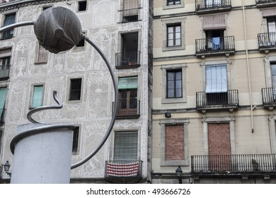 BARCELONA,SPAIN-SEPTEMBER 9,2015: George Orwell square in gothic quarter of Barcelona. Facade houses and sculpture reproduction of one work of surreal sculptor Leandre Cristofol.