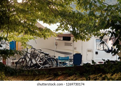 Barcis, Pordenone, Italy a picturesque place camping tourist parking by cars and bicycles.