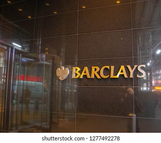 Barclays bank gold logo and sign on the marble wall in New York, USA . New York , NY/USA-December 4,2018