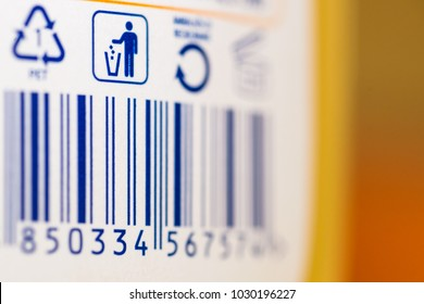 Barcode numbers with garbage symbol and symbol for recycling on a plastic product in a store