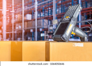 Barcode scaner on cardboard boxes in warehouse distribution center.