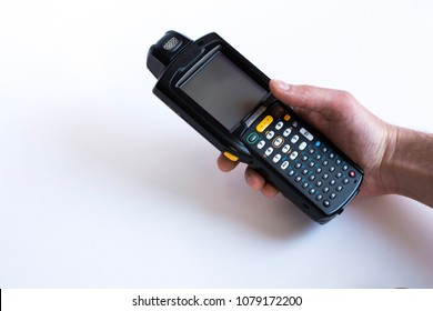 Barcode scanner in hand on white background