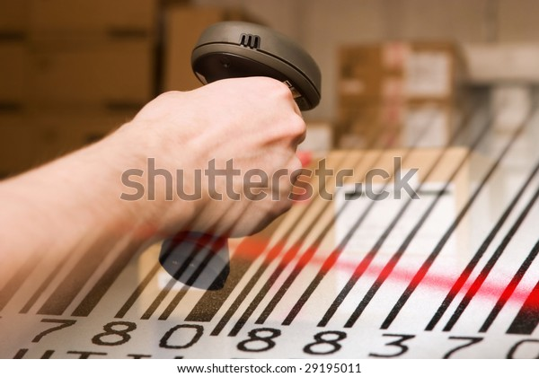 Barcode scanner and label with red laser beam. Warehouse concept.