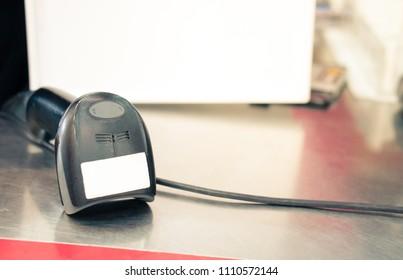 Barcode scanner on the supermarket cashier, buy order check