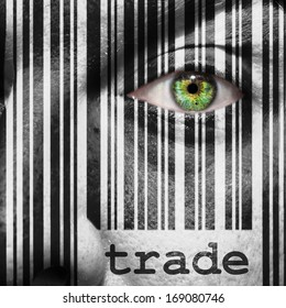 Barcode with the word trade as concept superimposed on a man's face