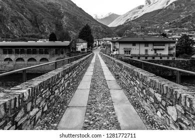 Bard, Valle d'Aosta, Italy, January 3, 2019: medieval bridge on the Dora Baltea river that connects Bard with Hone