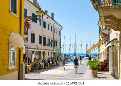 Bardolino, Italy - August 11, 2008: Garda lake, tourists in the old village
