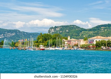 Bardolino, Italy - August 11, 2008: Garda lake, the village with the harbor seen from the lake