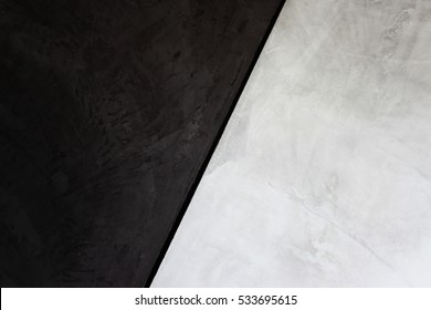 Bare cement vintage wall white and black,in dark tone wall.two tone wall.