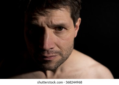Bare Chested Man With Half Face In Shadow