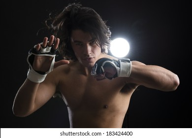 Bare chested young Malaysian boxer fighting