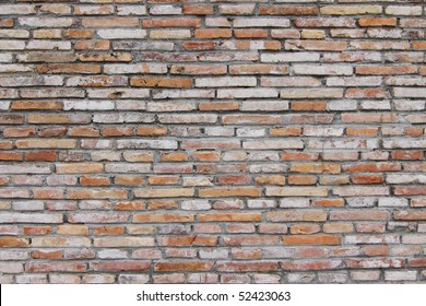 A bare and exposed brick wall ideal for backgrounds