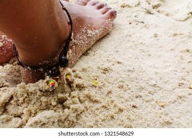 Bare feet on the sand