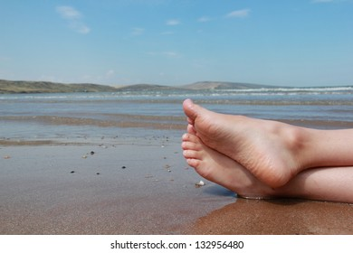 Bare feet in the water of the sea