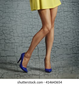 bare female legs in high heel shoes