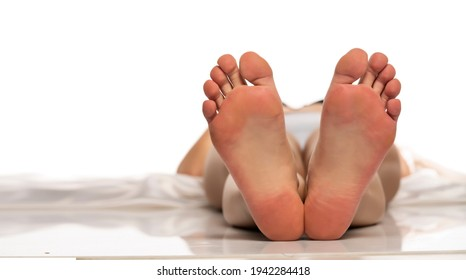 Bare female soles on a white background