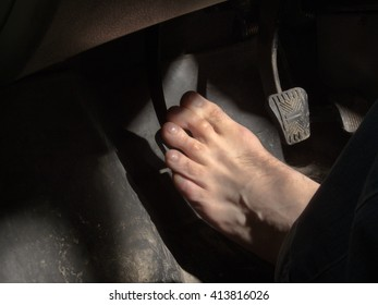 bare foot on the clutch pedal