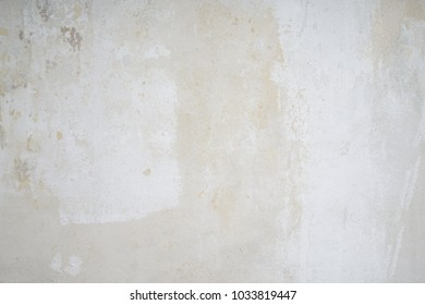 bare interior wall after wallpaper was removed, shabby grunge background texture