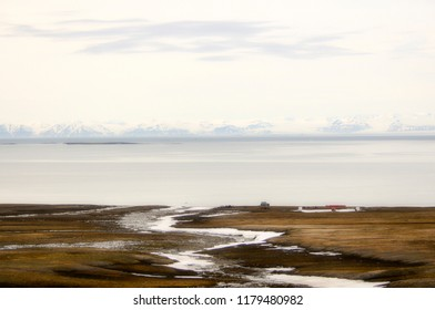 Bare Land and a Snow Capped Mountain Range at the Edge of the Arctic Ocean on the Coast of Spitsbergen Svalbard Archipelago in Northern Norway