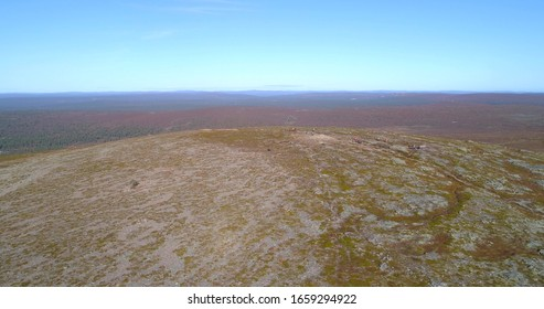 Bare mountain in Lapland, Aerial, tracking, drone shot, panning around the Kiilopaa fell and nature in Urho Kekkonen national park, on a sunny autumn day, in Saariselka, Lappi, Finland